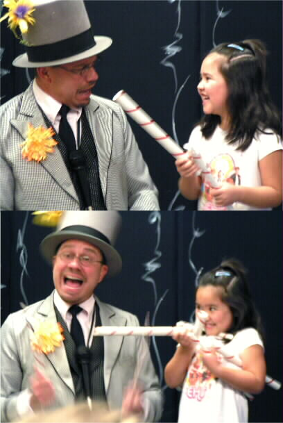Helper having fun with Doug Hoover at his magic show!